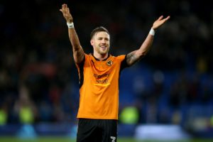 Leeds have announced the signing of left-back Barry Douglas from Premier League club Wolves.