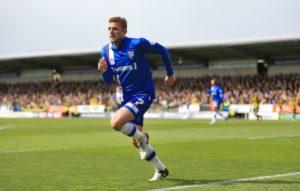 Shrewsbury have signed midfielder Doug Loft following a successful trial.