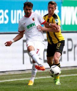 Huddersfield have signed Germany international Erik Durm from Borussia Dortmund