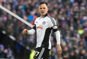 Lawrence Shankland hit a double as Ayr dumped nine-man Dundee out of the Betfred Cup at Dens Park.