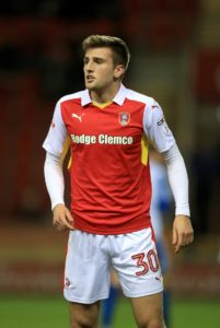 AFC Wimbledon have signed defender Ben Purrington from Rotherham on a season-long loan.