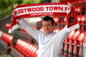 Joey Barton begins his managerial career in earnest on Saturday as Fleetwood take on AFC Wimbledon.