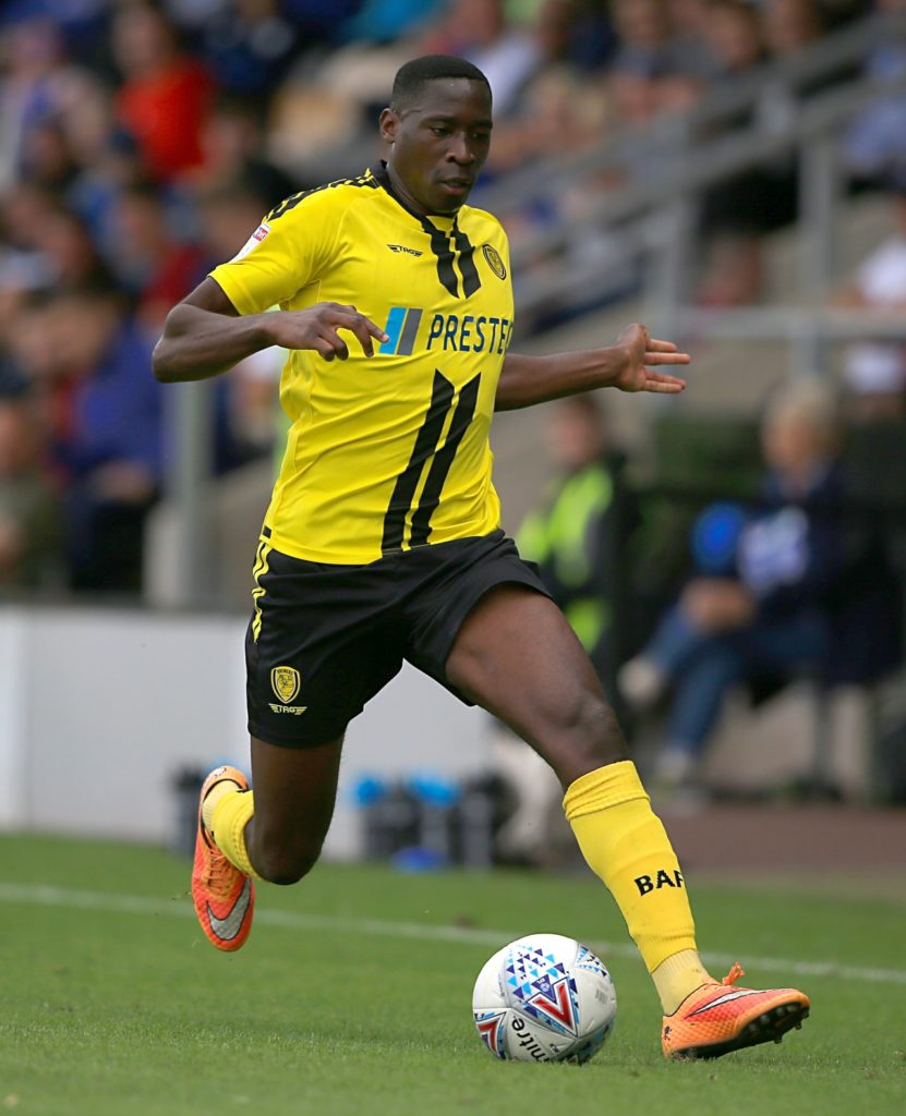 Lucas Akins scored the winner from the penalty spot as Burton came from a goal down to beat Shrewsbury 2-1 in the first round of the Carabao Cup.
