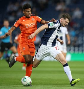 Oliver Burke's first West Brom goal downed plucky Luton and sent the Baggies into the second round of the Carabao Cup with a 1-0 win.