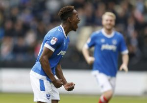 Jamal Lowe's first-half strike was enough to lead Portsmouth to a fortuitous 1-0 win over newly-promoted Luton at Fratton Park.