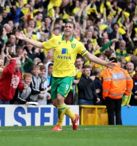 Striker Grant Holt has announced his retirement from football to concentrate on a new coaching role at Norwich.
