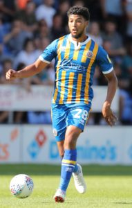 Shrewsbury picked up their first point of the season from a 0-0 draw with Blackpool.
