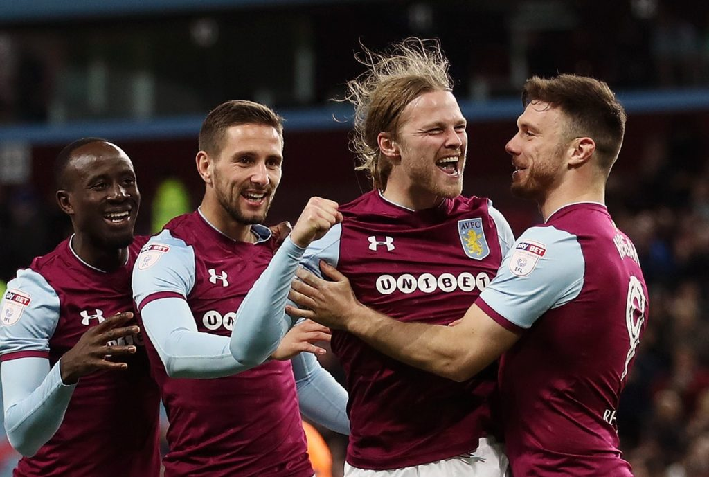Birkir Bjarnason came up with an added-time winner to give Aston Villa a somewhat fortunate 3-2 success over a battling Wigan.