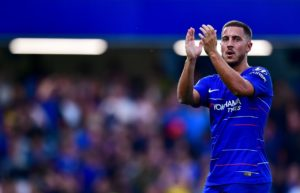 Eden Hazard will not be pushing for a move to Real Madrid before the transfer window closes and is happy with Chelsea for now.