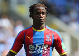 Wilfried Zaha insists he's always been focused and committed to Crystal Palace and remains in talks over a new deal.