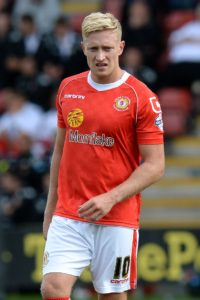 Morecambe boss Jim Bentley has ended a long pursuit by finally signing striker AJ Leitch-Smith.
