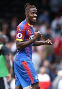 Wilfried Zaha says he is 'very pleased' after signing a new five-year contract with Crystal Palace.