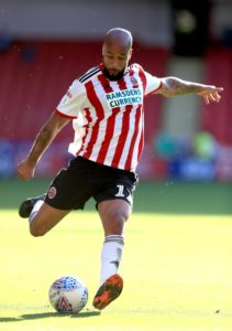 David McGoldrick's 65th-minute penalty earned Sheffield United a 2-1 victory at QPR in the Sky Bet Championship.