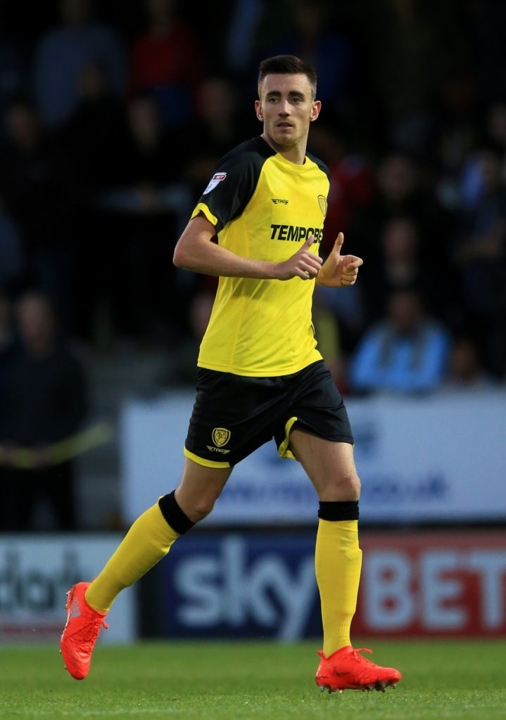 Scunthorpe have signed Burton midfielder Matthew Lund on a two-year deal.