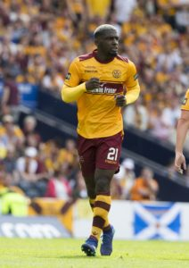 Wigan have signed defender Cedric Kipre for what could turn out to be a record fee for Motherwell.