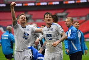 Tranmere have a doubt over defender Ritchie Sutton for their Carabao Cup tie with Walsall.