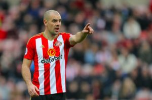 Wigan have bolstered their squad on the eve of their Championship return with the double signing of Darron Gibson and Cedric Kipre.