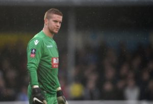 Debutant goalkeeper Ben Amos pulled off two penalty saves to inspire Millwall to a 3-1 shoot-out victory over Gillingham in the Carabao Cup.