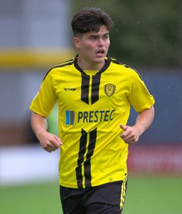 Midfielder Elliot Hodge is eyeing a place in Burton's starting line-up after signing a short-term contract at the club.