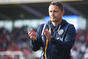 New Ipswich boss Paul Hurst's first game ended all-square after an injury-time equaliser rescued a point against Blackburn in a 2-2 draw at Portman Road.
