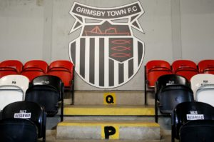 Grimsby have announced that a fan was arrested for allegedracist behaviour during Saturday's League Two defeat at Newport.