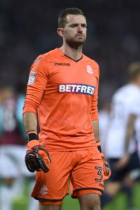 Goalkeeper Mark Howard made a string of fine saves in his second debut for Blackpool to help the Seasiders claim a 0-0 draw at League One new boys Wycombe.
