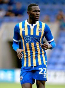 Ipswich have signed Shrewsbury pair Toto Nsiala and Jon Nolan.