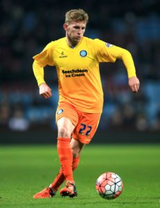 Defender Jason McCarthy could make a second Wycombe debut in Tuesday's Carabao Cup clash with Northampton.