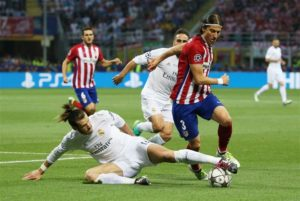 Atletico Madrid boss Diego Simeone says he's desperate to keep hold of Filipe Luis amid interest from Paris Saint-Germain.