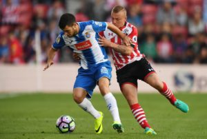 Espanyol defender Aaron Martin is on the verge of joining Mainz after travelling to Germany to undergo a medical.
