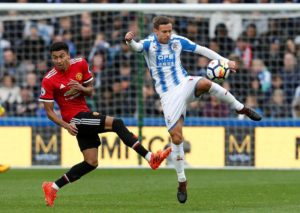 Huddersfield defender Chris Lowe admits they must cut out easy mistakes if they are to take anything off Manchester City.