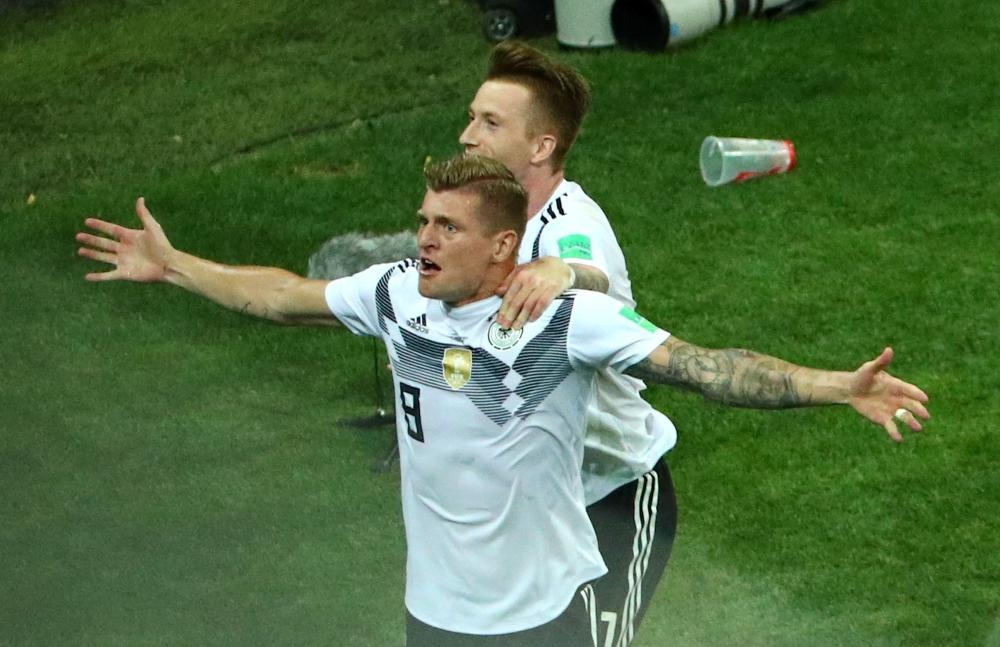 Germany midfielder Toni Kroos has criticised the manner of Mesut Ozil's departure following his retirement from international football.