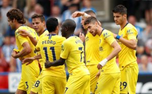 The Maurizio Sarri era got off to a perfect start for Chelsea as they cruised to victory over Huddersfield at the John Smith's Stadium.