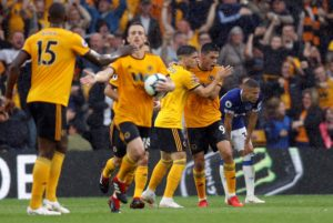 Raul Jimenez and Ruben Neves cancelled out Richarlison's brace as promoted Wolves drew 2-2 with 10-man Everton at Molineux.