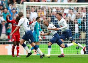 Kieran Tripper curled home a superb free-kick to inspire Tottenham Hotspur to a 3-1 victory over Fulham at Wembley.