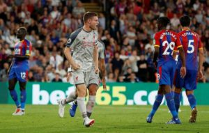 Goals from James Milner and Sadio Mane handed Liverpool a 2-0 win against ten-man Crystal Palace at Selhurst Park.