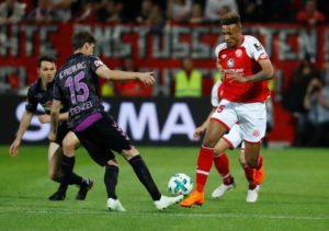 Mainz midfielder Jean-Philippe Gbamin has ended speculation over his future by signing a new five-year deal.