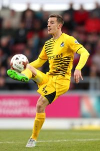 Defender Tom Lockyer is away on international duty with Wales and will miss Bristol Rovers' Sky Bet League One game against Plymouth.