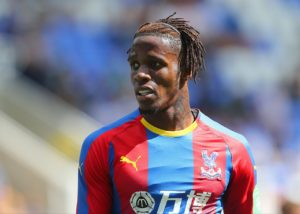 Wilfried Zaha's father has suggested the winger's absence from Ivory Coast duty could be for reasons other than injury.
