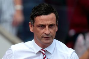 Sunderland manager Jack Ross paid tribute to the attitude his players showed to earn a point against Oxford despite being a man down.
