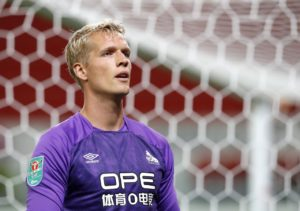 Goalkeeper Jonas Lossl says he is confident Huddersfield Town's strikers will start to fire on all cylinders.