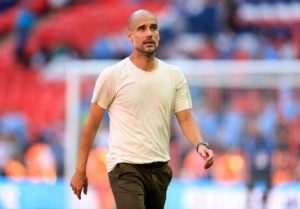 Manchester City boss Pep Guardiola says he wants to end his coaching career with Barcelona's youth teams.