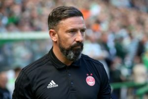 Aberdeen manager Derek McInnes praised his players' resilience after they triumphed on penalties over Hibernian to reach the Betfred Cup semi-finals.