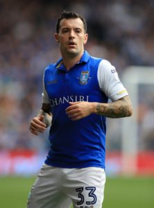 Joey Barton expressed his delight after beating a host of clubs to the signing of former Scotland winger Ross Wallace.