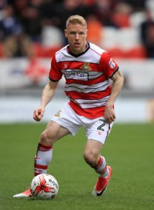Cheltenham have signed former Doncaster full-back Craig Alcock on a short-term contract.
