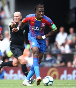 Christian Benteke will miss the clash with Huddersfield on Saturday but Wilfried Zaha has returned to training and could feature.
