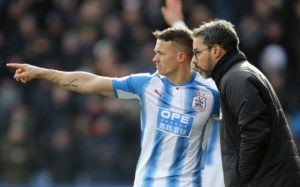 Huddersfield Town will welcome skipper Jonathan Hogg back to the side ahead of their trip to Leicester City on Saturday.