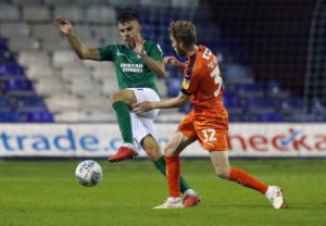 Luton have announced on-loan Leeds midfielder Eunan O'Kane sustained a fractured tibia and fibula during Saturday's 1-0 win over Bristol Rovers.