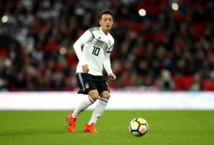 Mesut Ozil's agent has launched an attack on three German players after criticism of his client following his international retirement.