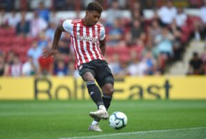 Brentford ended Nottingham Forest's unbeaten start to the Sky Bet Championship season with a 2-1 win in an ill-tempered battle at Griffin Park.